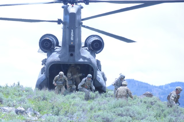 Training for the mountains of Afghanistan, the Army Reserve and Idaho Air National Guard take to the mountains near Boise, Idaho on June 21. Soldiers of Company B, 1/214th General Support Aviation Battalion practice inserting and extracting airmen of the 24th Aviation Support Operations Squadron, Joint Tactical Aircraft Controllers whose job it is to direct air assests in support of various joint and special operations.