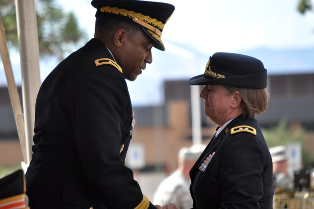 Maj. Gen. Jennifer Napper, commanding general, thanks Brig. Gen. Frederick Henry for a job well done as the command's deputy commanding general.