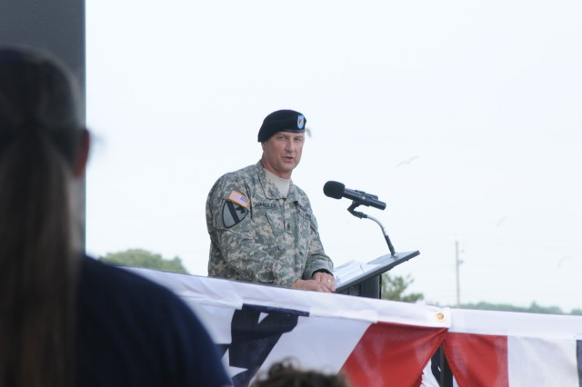 Sergeant Major of the Army Raymond Chandler speaks to Soldiers and Families during Fort Drum's annual Salute to the Nation ceremony June 28. Salute to the Nation was one of several events that took place during Mountainfest.