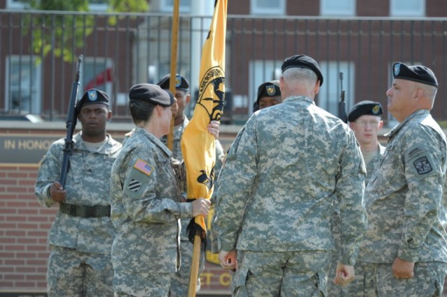 Col. Leona C. Knight has just accepted the guidon from Maj. Gen. Jefforey A. Smith, signifying her acceptance of the command of 7th Brigade, U.S. Army Cadet Command.