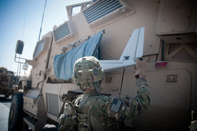 120625-A-3108M-001  GHAZNI PROVINCE, Afghanistan - U.S. Army Chief Warrant Officer 2 Dylan Ferguson, an AH-64 Apache pilot currently serving as a brigade aviation element officer with the 82nd Airborne Division's 1st Brigade Combat Team, unpacks a Puma unmanned aerial vehicle June 25, 2012, in southern Ghazni Province, Afghanistan. Ferguson uses the Puma for reconnaissance. (U.S. Army photo by Sgt. Michael J. MacLeod, Task Force 1-82 PAO)