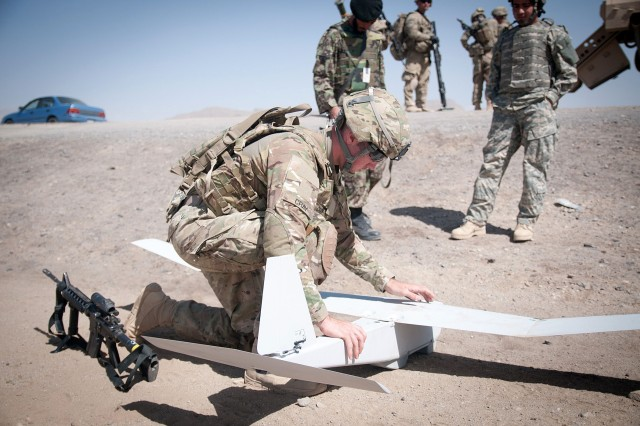 120625-A-3108M-004  GHAZNI PROVINCE, Afghanistan - U.S. Army Spc. Eric Cray, an aviation operations specialist with the 82nd Airborne Division's 1st Brigade Combat Team, attaches the wings of a Puma unmanned aerial vehicle to its fuselage June 25, 2012, Ghazni Province, Afghanistan. The Puma is used for reconnaissance for troops on the ground. (U.S. Army photo by Sgt. Michael J. MacLeod, Task Force 1-82 PAO)