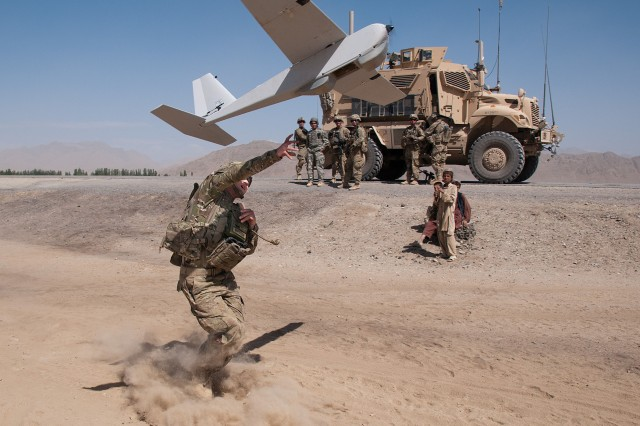 120625-A-3108M-005  GHAZNI PROVINCE, Afghanistan - U.S. Army Chief Warrant Officer 2 Dylan Ferguson, a brigade aviation element officer with the 82nd Airborne Division's 1st Brigade Combat Team, launches a Puma unmanned aerial vehicle June 25, 2012, Ghazni Province, Afghanistan. Ferguson uses the Puma for reconnaissance for troops on the ground. (U.S. Army photo by Sgt. Michael J. MacLeod, Task Force 1-82 PAO)