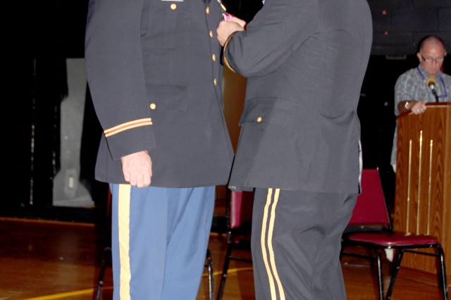 Former USAKA Commander Col. Joseph Gaines is pinned with the Legion of Merit medal by Lt. Gen. Richard Formica.