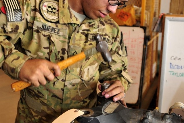 Private First Class Ranfi Jimenez, an aircraft powertrain repairer with Company D, 2nd Battalion, 25th Aviation Regiment, 25th Combat Aviation Brigade, and a native of Elizabeth, N.J., removes blade cuff washer on a main rotor blade for a UH-60 Black Hawk helicopter during a phase maintenance session on Forward Operating Base Wolverine, Afghanistan, June 12.