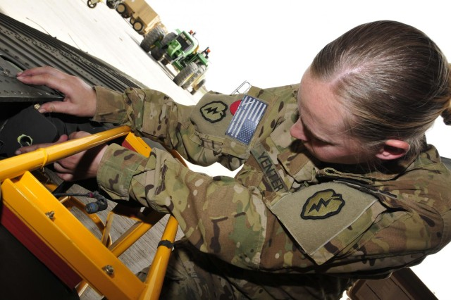 Specialist Melinda Yenter, a UH-60 Black Hawk crew chief with Company D, 2nd Battalion, 25th Aviation Regiment, 25th Combat Aviation Brigade, and a native from Salida, Colo., installs the stabalator hinge fitting on the horizontal stabalator for a UH-60 Black Hawk helicopter during a phase maintenance session on Forward Operating Base Wolverine, Afghanistan, June 12.