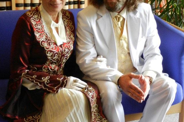 This Danish couple, dressed for the occasion, sits in the waiting area in anticipation of their ceremony.