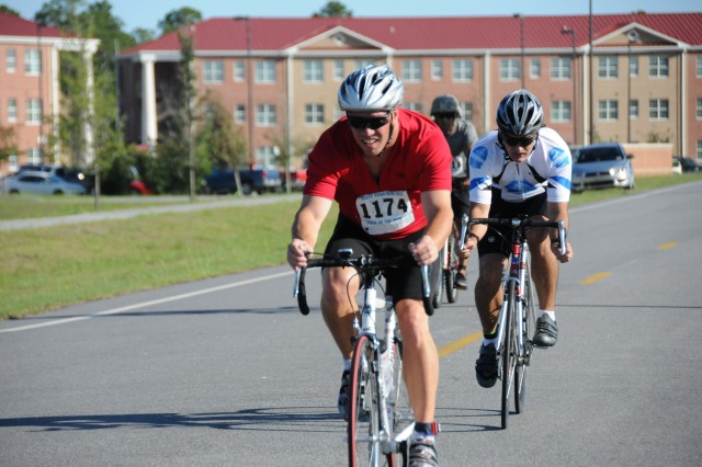 Capt. Eric Berisford, with the 3rd Combat Aviation Brigade, 3rd Infantry Division, races ahead of his opponents while competing in a triathlon as a part of Fort Stewart, Ga.'s Marne Week, June 27, 2012. The triathlon consisted of a 400-meter swim, 20-kilometer bike ride and a 5-kilometer run.