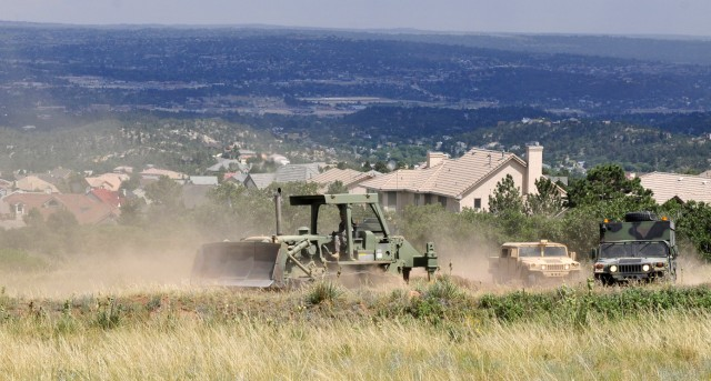 Bulldozers Clearing Firebreak Around U.S. Air Force Academy