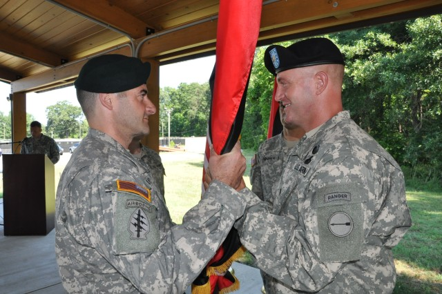 (Right) Lt. Col. Williams Huff, the outgoing commander for the Concepts Integration Squadron of the U.S. Army Asymmetric Warfare Group, passes the squadron's guidon to Col. Patrick J. Mahaney Jr., commander of the AWG and also the reviewing officer for the change of command ceremony held July 2 at Fort Meade, Md.  The Concepts Integration Squadron, one of four squadrons that make up the AWG, rapidly identifies, develops and integrates non-material and supports material solution development, which supports the unit's Group Priority Efforts to enhance Soldier survivability and Combat effectiveness. The Concepts Integration Squadron provides the linkage between global scout observations of AWG Operational Advisors into Training and Doctrine Command, the Army and across the Joint, Interagency, Multinational, Public and Private communities.