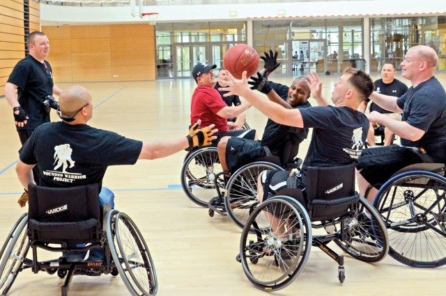 Warriors in Transition members scramble for a loose rebound during a session of wheelchair basketball June 22 at the Wiesbaden Fitness Center.