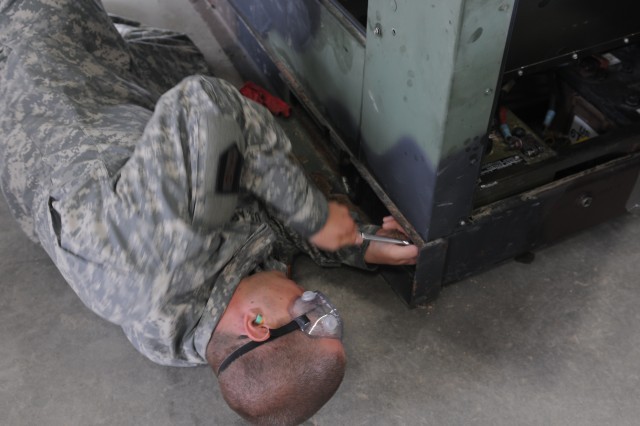 A mechanic with 302nd Maneuver Enhancement Brigade works around the clock to ensure equipment and vehicles are readily available to meet mission requirements at Warrior Exercise, Fort McCoy, June 19, 2012.  More than 1,100 Soldiers from 412th downtrace units were at Fort McCoy for extended combat training.