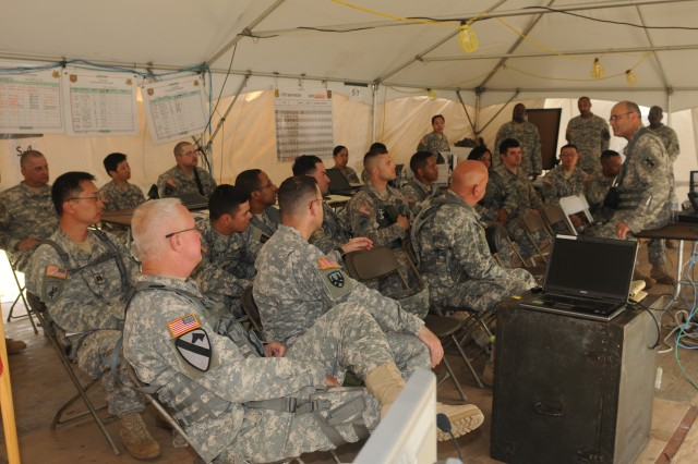 The 412th TEC command team, led by Maj. Gen. William Buckler, Jr., meets with 533rd Brigade Support Battalion, 302nd Maneuver Enhancement Brigade, at Warrior Exercise, Fort McCoy, June 19, 2012. The 412th command team spent three days observing troops in action and engaging with commanders about critical training objectives and strategies necessary to improve readiness levels and to meet Army Force Generation requirements. More than 1,100 Soldiers from 412th downtrace units were at Fort McCoy for extended combat training.