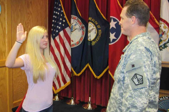 Cicely Verstein is sworn into the Army at the Beckley Military Entrance Processing Station, Beckley, W. Va., by the station commander, Maj. Adam Clark, June 29, 2012.  Verstein will be the first female 91M Bradley Fighting Vehicle System maintainer, one of six military occupational specialties that were restricted to men, but are now open to women.