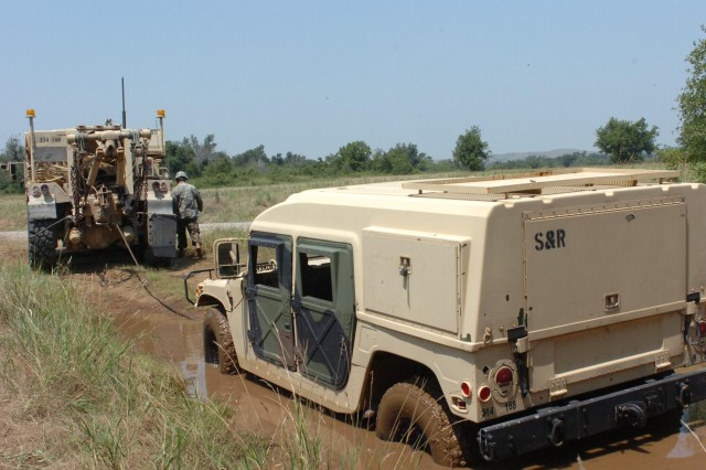 The 609th Recovery team winch a humvee out of the mud with a time of 16, minutes, 56 seconds. This was one of the events in the 168th Brigade Support Battalion's Best Logistician Competition.