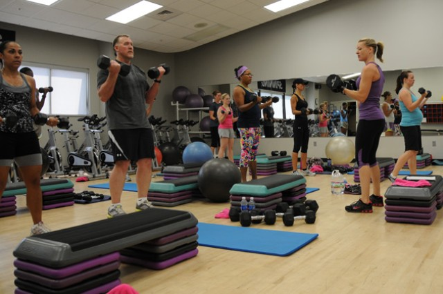 People participate in the Strong Bodies class at the Fortenberry-Colton Physical Fitness Facility June 29, using free weights to enhance their workout. The Strong Bodies class is one way that people can get out of the heat while maintaining their workouts.