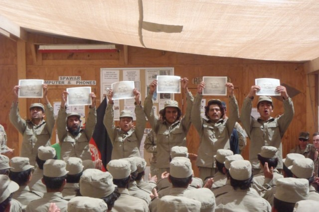 ZHARAY DISTRICT, Afghanistan - Afghan Local Police display their certificates during a graduation ceremony, July 3, 2012, in Zharay District, Afghanistan. The two-week course built proficiency on basic policing tasks and ethics and was instructed by members of the Afghan Uniformed Police and U.S. Soldiers.