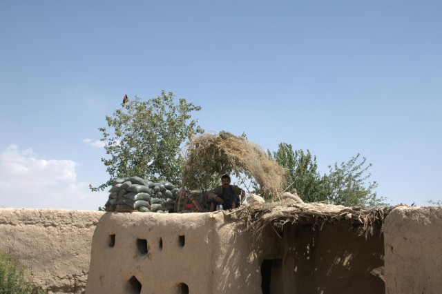 An Afghan local policeman mans his observation post in the village of Pankilla in Zharay district, Afghanistan, June 29, 2012. The Afghan local police live and work among the people in order to govern crime and assist the military forces with security.
