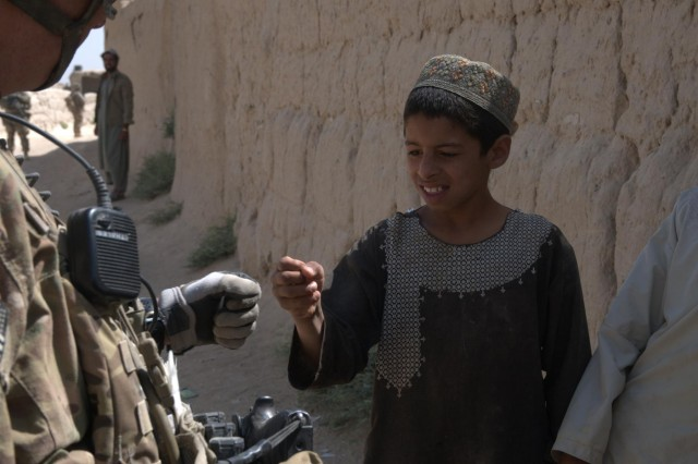 Lt. Col. Jeffery Howard, commander of 4th Squadron, 73rd Cavalry Regiment, greets a young boy in the village of Pankilla, Afghanistan, with a 'fist bump.'