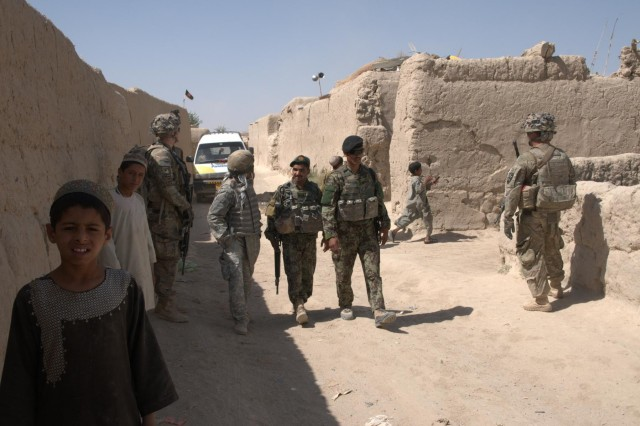 Afghan National Army soldiers of the 2nd Company, 2nd Kandak, 3rd Brigade, 205th Infantry Corps, walk through the streets of Pankilla, Afghanistan, after visiting with local policemen and villagers, June 29, 2012. This corner of the city was previously impassible due to enemy fighters.