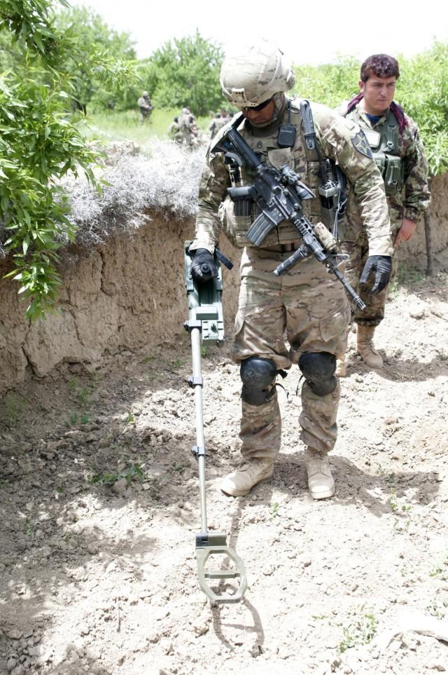 C-IED teams locate roadside bombs using metal detectors on steroids