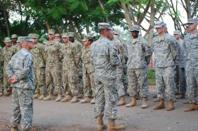 Missouri National Guard Lt. Col. Robert Jones, commander of Task Force Tropic, addresses the soldiers and sailors of Task Force Tropic before he and Sgt. Maj. Scott Mayer, of Lee