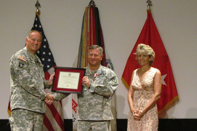 "Col. Chandler ""Skip"" Sherrell and his wife Lauri receive recognition during his retirement ceremony officiated by retired Maj. Gen. Jim Rogers, who was Sherrell's commander during his service at the Aviation and Missile Command."