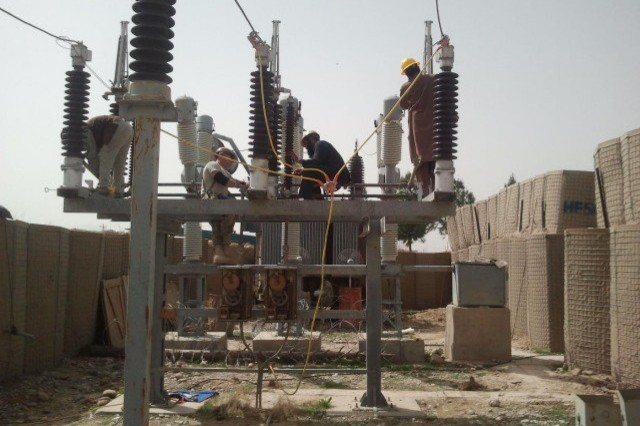 Afghan and U.S Army Corps of Engineers engineers and electricians clean, repair and service the 110kV main disconnect switch assembly at the Sangin Substation in Helmand province, Afghanistan. The Sangin substation will be repaired under a USACE-awarded contract to improve transmission lines and substations in the Helmand province.