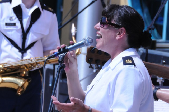 "Staff Sgt. Sherri Wornath of the 100th Army Band out of Fort Knox, Ky., sings the Gershwin aria ""Summertime"" on July 3 in Gatlinburg, Tenn. The 100th marched in the 37th Annual Fourth of July Midnight Parade which kicked off at 12 a.m., marking it as the first, chronologically, of the nation's celebrations, a distinction the City of Gatlinburg maintains with pride. On July 3rd, some of the band's Music Performance Teams, such as the Jazz and Rock Bands and the Brass Quintet played in front of the city's Aquarium in temperatures that reached 94 degrees. The entire band also played a patriotic concert on the evening of the 4th leading into the traditional fireworks show."