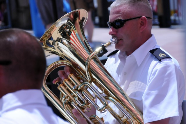 The stripes of Old Glory are reflected in the tuba of Staff Sgt. Bryan Brown as the 100th Army Band's Brass Quintet perform in Gatlinburg, Tenn. on July 3. The 100th marched in the 37th Annual Fourth of July Midnight Parade which kicked off at 12 a.m., marking it as the first, chronologically, of the nation's celebrations, a distinction the City of Gatlinburg maintains with pride. On July 3rd, some of the band's Music Performance Teams, such as the Jazz and Rock Bands and the Brass Quintet played in front of the City's Aquarium. The entire band also played a patriotic concert on the evening of the 4th leading into the traditional fireworks show.