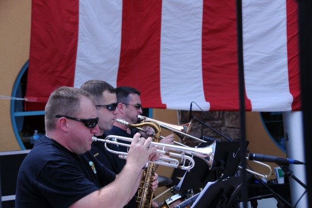 Soldiers of the 100th Army Band's musical performance team, Hard Knox, play on July 3 in Gatlinburg, Tenn. The 100th marched in the 37th Annual Fourth of July Midnight Parade which kicked off at 12 a.m., marking it as the first, chronologically, of the nation's celebrations, a distinction the City of Gatlinburg maintains with pride. On July 3rd, some of the band's Music Performance Teams, such as the Jazz and Rock Bands and the Brass Quintet played in front of the City's Aquarium. The entire band also played a patriotic concert on the evening of the 4th leading into the traditional fireworks show.