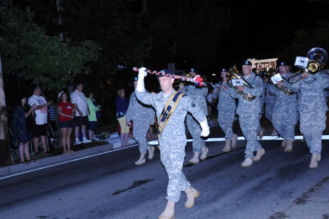 Staff Sgt. Billy Arnold leads the 100th Army Band as they march in the 37th Annual Fourth of July Midnight Parade which kicked off at 12 a.m., marking it as the first, chronologically, of the nation's celebrations, a distinction the City of Gatlinburg, Tenn. maintains with pride. On July 3rd, some of the band's Music Performance Teams, such as the Jazz and Rock Bands and the Brass Quintet played in front of the city's Aquarium. The entire band also played a patriotic concert on the evening of the 4th leading into the traditional fireworks show.