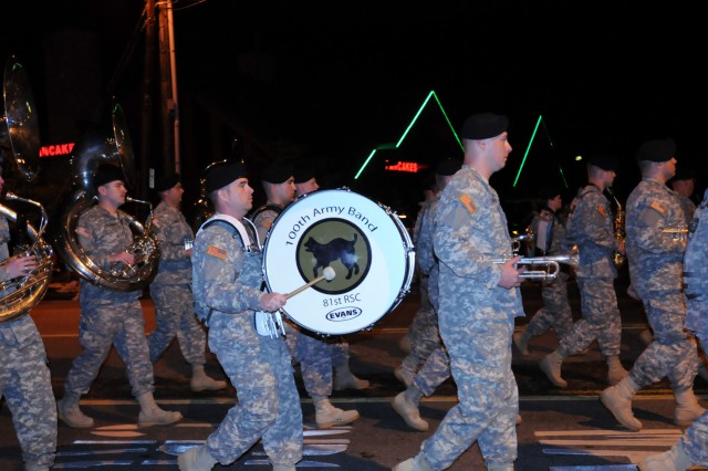 The 100th Army band marches in the 37th Annual Fourth of July Midnight Parade which kicked off at 12 a.m., marking it as the first, chronologically, of the nation's celebrations, a distinction the City of Gatlinburg, Tenn. maintains with pride. On July 3rd, some of the band's Music Performance Teams, such as the Jazz and Rock Bands and the Brass Quintet played in front of the City's Aquarium. The entire band also played a patriotic concert on the evening of the 4th leading into the traditional fireworks show.