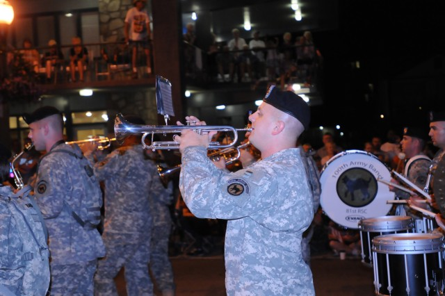 Spec. Joshua Betz plays trumpet as the 100th Army Band marches in the 37th Annual Fourth of July Midnight Parade which kicked off at 12 a.m., marking it as the first, chronologically, of the nation's celebrations, a distinction the City of Gatlinburg maintains with pride. On July 3rd, some of the band's Music Performance Teams, such as the Jazz and Rock Bands and the Brass Quintet played in front of the City's Aquarium. The entire band also played a patriotic concert on the evening of the 4th leading into the traditional fireworks show.