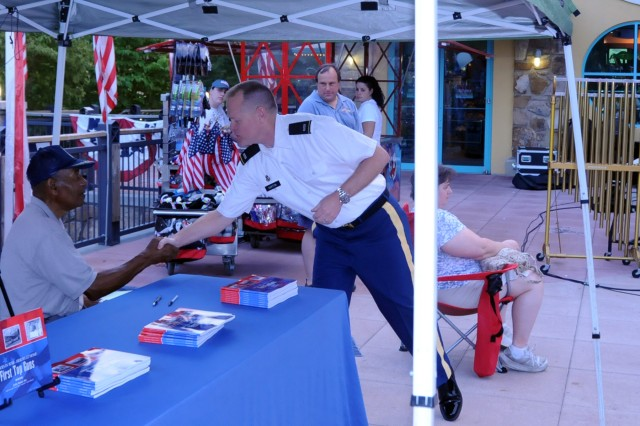 Chief Warrant Officer 5 Lawrence Barton, commander of the 100th Army Band from Fort Knox, Ky., greets Lt. Col. (Ret) Edgar Lewis on July 4 in Gatlinburg, Tenn. Lewis is one of the original Tuskegee Airmen and was present for the band's evening concert. The 100th marched in the 37th Annual Fourth of July Midnight Parade which kicked off at 12 a.m., marking it as the first, chronologically, of the nation's celebrations, a distinction the City of Gatlinburg maintains with pride. On July 3rd, some of the band's Music Performance Teams, such as the Jazz and Rock Bands and the Brass Quintet played in front of the City's Aquarium. The entire band also played their patriotic concert on the evening of the 4th leading into the traditional fireworks show.