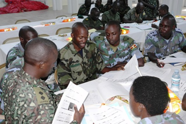 Students break into small groups to prepare a convoy movement and briefing during a February 2012 training event. Africa Deployment Assistance Partnership Teams traveled to Uganda to train Ugandan soldiers in logistics requirements for deployments.