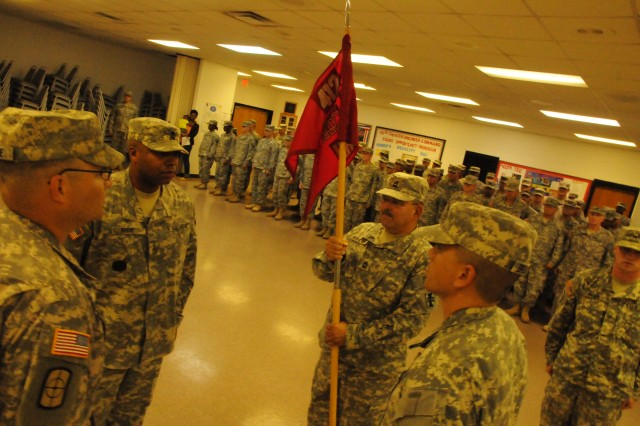 "GEORGE A. MORRIS ARMY RESERVE CENTER, Miss.""Soldiers, families and friends looked on as HHC, 412th Theater Engineer Command, transfers responsibility from outgoing first sergeant, 1st Sgt. Julius Horne, to incoming first sergeant, 1st Sgt. Richard Broussard, during a change of responsibility ceremony held here July 8, 2012."