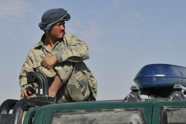 A member of the 3rd Zone Afghan Border Police scans the horizon at a hasty checkpoint along a supply route during Operation Buffalo Thunder II in Baradge Kotal, Afghanistan, June 29, 2012. During the eight-day mission, Afghan and American forces cleared more than 120 kilometers of rugged terrain and escorted approximately 60 truckloads of humanitarian aid for distribution to the people of Shorabak.