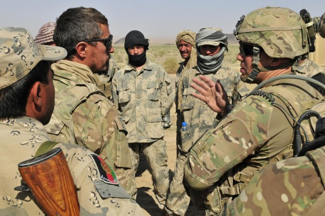 Maj. Gregory Sakimura, operations officer of the 1st Battalion, 17th Infantry Regiment, 2nd Infantry Division speaks with members of the Afghan Border Police during Operation Buffalo Thunder II near Baradge Kotal, Afghanistan, June 29, 2012.