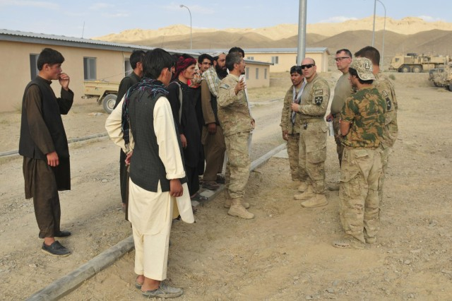 Maj. Gregory Sakimura (fourth from right), operations officer with the 1st Battalion, 17th Infantry Regiment, 2nd Infantry Division, speaks with the local Afghans during Operation Buffalo Thunder II, in a secure area at the district center in Shorabak, Afghanistan, June 30, 2012. During the eight-day mission, Afghan and American forces cleared more than 120 kilometers of rugged terrain and escorted approximately 60 truckloads of humanitarian aid for distribution to the people of Shorabak.