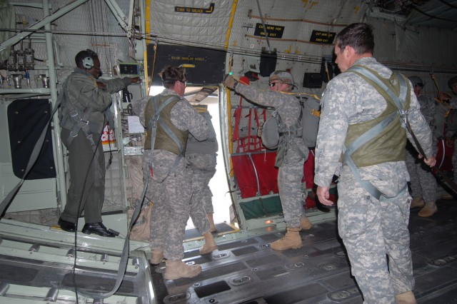 U.S. Special Forces Soldiers from 10th Special Forces Group (Airborne) out of Fort Carson, Colo., jump out of a Botswana Defense Force C-130 aircraft for the combined U.S. Special Forces and Botswana Defense Force Special Forces parachute jump in the final week of Exercise Eastern Piper 12.