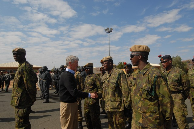 Secretary of the Army John McHugh coins the participants of Eastern Piper 12, a three-week Foreign International Defense structured Counter-Terrorism base exercise to improve mutual and combined Special Operational Forces capabilities and maintain relationships between U.S. and Botswana Defense Special Forces.