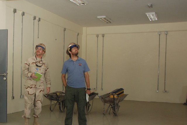 Jackson VanPelt (left), project engineer, and Tariq Taheri, Afghan Project Engineer, inspect a recently finished classroom in one of several buildings nearing completion on the 9th Commando compound in Herat, Afghanistan, July 2, 2012. Work on the $13.7-million project is scheduled to be completed by late July.