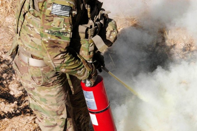 Second Lt. Alex Armstrong, Platoon Leader, 1st Platoon, 288th Sapper Company, Mississippi Army National Guard, uses a fire extinguisher to make sure no fire catches after an Afghan National Army Engineer blew-in-place an improvised explosive device found during a route clearance mission in Uruzgan province, Afghanistan, July 7, 2012.