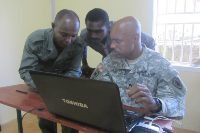 Staff Sgt. David Gilbert, squad leader, 3rd Squadron, 124th Cavalry Regiment, Texas National Guard, assigned to the Combined Joint Task Force -- Horn of Africa, discusses self-development methods with Comorian Army of National Development noncommissioned officers during a five-day noncommissioned officer development seminar at the National School of Army and Gendarmerie, held June 12-16, 2012. Noncommissioned officers from the U.S. and Comorian armies partnered together to share best practices of basic NCO skills.