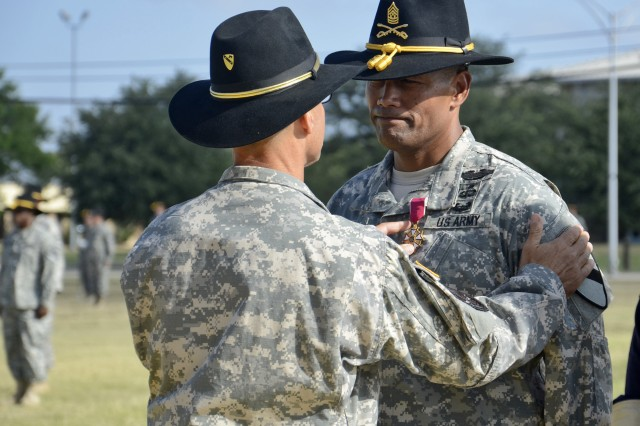Command Sgt. Maj. Isaia Vimoto, former command sergeant major of the 1st Cavalry Division, receives the Legion of Merit Medal from Maj. Gen. Anthony Ierardi, commanding general of the 1st Cav., during a patch ceremony to recognize Vimoto and the changing of the division's deputy commanding general of support, July 5, 2012, on Cooper Field at Fort Hood, Texas. Vimoto is moving on to Fort Bragg, N.C. to be the command sergeant major of the XVIII Airborne Corps.