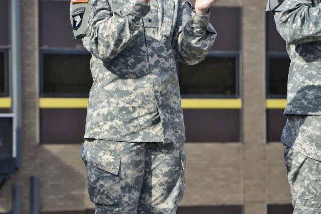 "FORT HOOD, Texas - Brig. Gen. Laura Richardson, deputy commanding general of support for the 1st Cavalry Division, claps to the playing of  ""Garry Owen"" during a Patch Ceremony, July 5, 2012, on Cooper Field at Fort Hood, Texas. This Patch Ceremony farewelled Command Sgt. Maj. Isaia Vimoto, former division command sergeant major, and recognized the division's changing of deputy commanding general of support from Brig. Gen. James Richardson to Brig. Gen. Laura Richardson. With taking this position, Brig. Gen. Laura Richardson is making a first in the history of the Army by being the first female deputy commanding general of a maneuver division."