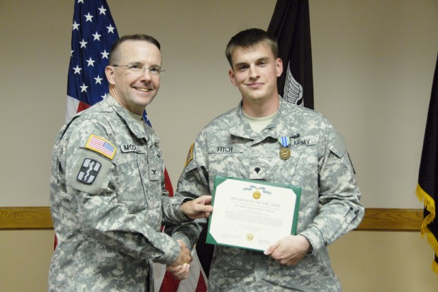 Spc. Trevor Fitch, right, receives an Army Achievement Medal from Col. John Modell during a June awards ceremony at William Beaumont Army Medical Center. Fitch donated platelets eight times within the last year.