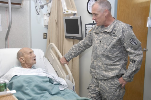 William Beaumont Army Medical Center Chief of Staff Col. Michael Amaral, right, listens as 106-year-old Willie Kucera shares stories of being in the Army during World War II and the Korean War.
