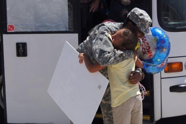 Spc. Lawanda Tidwell, Company B, 40th Expeditionary Signal Battalion, is greeted by her daughter after a mission to Honduras that lasted several months.